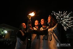 #Baylor students hold the Immortal Flame as fireworks go off on campus during Homecoming 2012. #BUHC12
