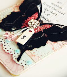 Dark Black Butterfly on shabby tag
