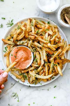 This copycat recipe of the famous Gordon-Biersch garlic fries couldn't be easier to make at home, and because they can be baked in the oven or the air fryer, they're a healthier version, too. Vegetarian Recipes, Cooking Recipes, Healthy Recipes, Garlic Recipes, Potato Recipes, Rosemary Recipes, Cod Recipes, Ramen Recipes, Chickpea Recipes