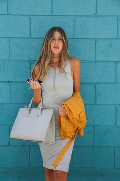 Hanna Montazami carries The Strathberry Tote in Pearl Grey
