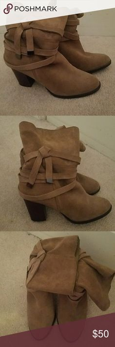 Brown Suede slouch ankle boots Excellent condition, so on Trent Brown slouch ankle boots. 3 inch heel. Small tear in the suede, see picture a cobbler can fix or just leave it you can't see it when on. Saks Fifth Avenue Shoes Ankle Boots & Booties