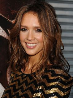 Jessica Alba's Hair Highlights Copper-kissed highlights give Jessica Alba's chocolate brown hair major dimension—if you have warm undertones and a dark base, this low-commitment style does the work for you. Photo Credit: Getty Images, courtesy of iVillage