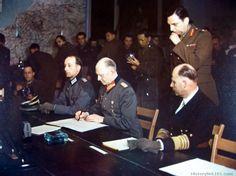 General Adm. Von Friedeburg, Col. Gen. Gustaf Johl, members of the German delegation. Gen. Jodl is just signing the articles of unconditional surrender. Rheimn, France. May 7, 1945