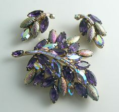 Hollycraft Purple Rhinestone Foil Cabochon Demi Parure. Set in gold tone metal with purple and AB rhinestones with shimmery foiled cabochons. All pieces signed Hollycraft. Measures 3 and the clip earrings are 1 1/4 Very good condition.  For more vintage jewelry click here: http://www.etsy.com/shop/vintagelanejewelry  I describe my jewelry to the best of my ability, minor imperfections and wear consistent with age may be expected. Customer satisfaction is important to me. Any problems, I will…
