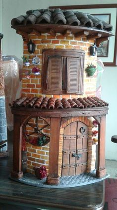 Round fairy house with bricks and rustic front door | fairiehollow.com