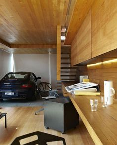 This is a #garage & #work space to die for. Check out that wood finish, and imagine looking at your #porsche all day.