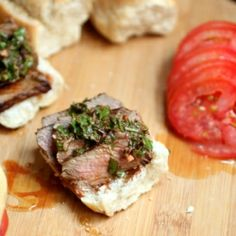 Marinated rump steak with galicky chimichurri sauce and fresh tomatoes in a crusty french bread roll