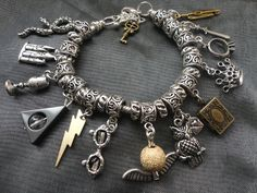 Harry Potter Inspired, 7 Horcruxes, Deathly Hallows Charm Bracelet. love it want it