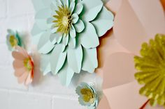 A pretty glittery set of paper wall flowers.  This set of 13 paper flowers are lovely addition to your decor. They really add the wow factor to a wedding or any special event! You can choose up to 2 paper colours from a choice of 40, with two glitter colours options for the centres. All the flowers come separately giving maximum versatility, use them together or individually! All handmade in east london from high quality paper, they are suprisingly sturdy, treat them well and you can use…