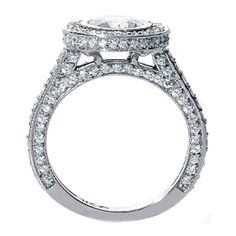 It's hard to find side images, but this one I like. Of course, I like the 3-sided pave! I really like the diamonds all around on the upper setting, encircling the main stone. It looks careful and graceful.
