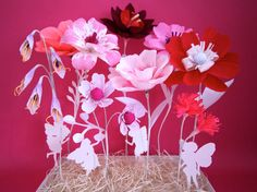 A Whimsical Fairy Garden Crepe Paper Flowers with Fairy Silhouette Cutouts