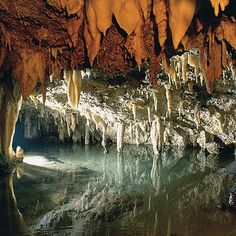 .The Cave of the Winds was formed in the limestone layers roughly 4-7 million years ago while the layer was still under the water table. Rainwater mixed with carbon dioxide and formed a weak carbonic acid. The acid solution dissolved away portions of the limestone leaving behind the passageways and rooms you can see today. When the water table dropped below the level of the caves...stalactites, stalagmites, draperies, flowstone and more.