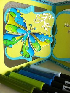 For the coloring I used the Tombow markers nrs 491, 493, 528, 133 and nr 098. The Peel Off stickers I used are the 0412 Big Butterflies in silver, 395 Happy Birthday in silver, the 1283 Swirls in silver and the glitterlines nr 7010 in Turquoise.I love the Accordion Flip 3-D bigz die from Karen Burniston. For this card I used two dies. The Accordion Flip 3-D (658035) and the Frame & Label Bracket (658037)