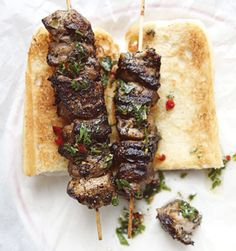 """Spiedies by Saveur. These tangy pork kebabs are rubbed with garlic and dry herbs, and basted with a vinegar wash. A regional favorite of New York State's Southern Tier, their name derives from the Italian spiedino or spiedo (""""skewer"""" and """"spit""""). Best Sandwich Recipes, Kebab Recipes, Grilling Recipes, Pork Recipes, Cooking Recipes, Barbecue Recipes, Spiedies Recipe, Agrodolce Recipe, Gastronomia"""