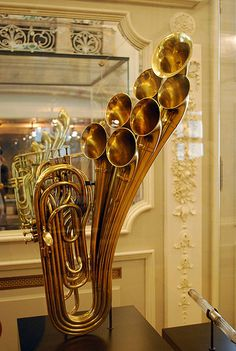 Antique brass instrument on display at the Musical Instrument Museum in Brussels, Belgium This is a six-valved, seven-belled valve trombone by Adolf Sax. Each valve coincides with one position on a slide trombone.