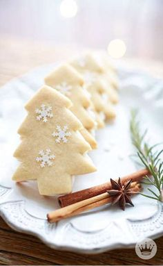 Want to up your food presentation game this season? Do more with less. A couple cinnamon sticks, a star anise, and a Christmas tree sprig will lend a cookie plate a holiday air without going over-the-top. Click through for 13 delicious (and simple) Christmas cookie recipes from Hallmark to get you started.