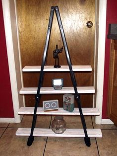 adorable shelf unit made from a pair of old crutches.