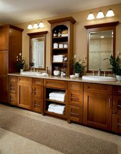 Warm wood bathroom with Kraftmaid double vanities and tall, counter storage. Kitchen Design Group in Shreveport, LA is a dealer of Kraftmaid cabinets. Master Bath Remodel, Master Bathroom, Brown Bathroom, Narrow Bathroom, Gold Bathroom, Basement Bathroom, Dream Bathrooms, Beautiful Bathrooms, Modern Bathrooms