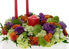How to create a contemporary Thanksgiving centerpiece with a triadic color harmony.  http://www.floraldesigninstitute.com/Media/Movie0289-Thanksgiving-Triad/Thanksgiving-Triad.htm