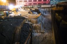 Sea water floods the Ground Zero construction site, Monday, Oct. 29, 2012, in New York. Sandy continued on its path Monday, as the storm forced the shutdown of mass transit, schools and financial mark