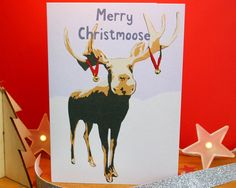 A funny moose Christmas card featuring a printed reproduction of an original multi-layered papercut artwork, handmade by myself, inspired by winter wonderland animals and the mountains of Machu Picchu. This design features a moose with bells on its antlers and the text Merry Christmoose in my own unique typeface.  Blank inside for your own message.  Size The card is A6 size, measuring approx. 148mm x 105mm (5.83 x 4.13 inches). The matching C6 envelope is slightly larger.  Eco Friendly…