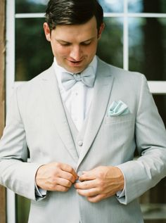 A gray suit and a touch of teal: Photography : Kylie Martin Photography Read More on SMP: http://www.stylemepretty.com/2016/07/13/st-simons-teal-colored-wedding/