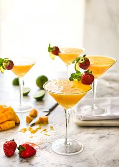 The king of all cocktails - MANGO DAIQUIRI! There is no better way to celebrate the best of Aussie summer than with big, juicy, ripe mangoes. Make these straight up, with or without a blender, or make slushy frozen Mango Daiquiris! Frozen Strawberry Daiquiri, Mango Daiquiri, Frozen Watermelon, Frozen Strawberries, Watermelon Lemonade, Make Simple Syrup, Recipetin Eats, Coconut Rum, Summer Drinks