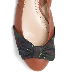 Brooks Brothers does...ballet flats w/ bows? www.brooksbrothers.com