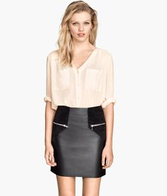 Faux leather mini skirt with imitation suede accent panels, paired with an airy ivory blouse to soften the look. | H&M Divided