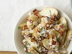 Fingerling potato salad with bacon and sun-dried tomatoes - countryliving. Homemade Potato Salads, Best Potato Salad Recipe, Creamy Potato Salad, Potato Salad With Egg, Potato Salad Mustard, Potato Salad Dressing, Salad Dressing Recipes, Bacon Dishes, Ground Beef Recipes