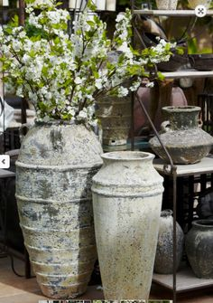 Tall vases with stem heavy flowers. Silk or fresh. You pick!