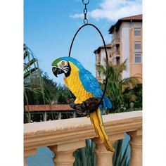 Polly in Paradise Parrot Sculpture on Ring Perch: Medium $89.95