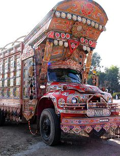 Pakistan's public transportation. Every bus is decorated uniquely.