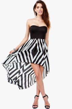 There's something so clean and classic about the black-and-white color combination. Strapless dress with a knit top and a diamond geo printed skirt. Cut-out detail on back with elastic strap across. Hi-lo silhouette. Sweetheart neckline.