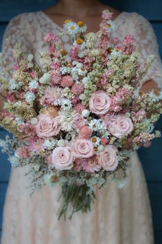 Lovely dried wedding flower bouquet, just perfect for any spring wedding! This bridal bouquet made of beautiful dried flowers can be shipped right to your door! See more like this at pickabloom.com!