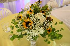 Bridal bouquet made with sunflowers, roses, gerber daisies, black-eyed susan, solid aster, baby's breath, and buplerum. *Creative Touches Evansville*