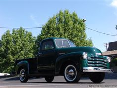 1949 Chevy. White wall tires with Crome in the middle. MMM-mm. That there is one delicious looking truck.