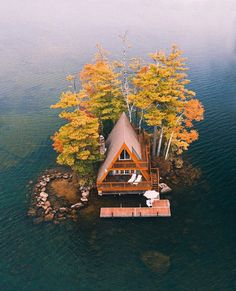 This a-frame is on an island in Lake Winnipesaukee, New Hampshire. The island is about 20 feet from the shore of Oliver Lodge. There's a floating dock used for sunbathing, canoes and small boats.The house faces due south and receives sun all. A Frame Cabin, A Frame House, Lake Cabins, Cabins And Cottages, Mountain Cabins, Cabins In The Woods, Cabin On The Lake, House By The Lake, Cabin Homes