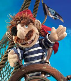 The PIRATE, named BLIMEY, features an eye patch, gold tooth, earring, bandana, and a stitched scar on his nose. The details make this 12-inch-tall puppet fun to operate. Movable mouth and arms.