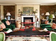 Love the wonderful green armchairs in this room combined with the red of the footstool and club fender at the fireplace - something we often suggest to clients to create additional sociable seating and they can be made to look traditional and contemporary depending on the fabric! Lovely inspiration. #interiors #designerplease #interiorsinspiration #interiordesigner #interiordecoration #salvesengraham