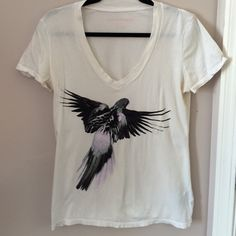 Norma Kamali graphic tee A grey, black and pink parakeet adorn this awesome tee. Worn a few times. In excellent condition Norma Kamali Tops Tees - Short Sleeve
