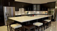 Stunning #modern #kitchen with brown and white dining set Visit http://www.suomenlvis.fi/