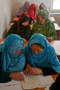 women read along together in a lesson during an ARZU literacy class in Bamyan, Afghanistan.
