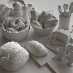raw clay render of pastries. The camera angle is just so that it is like sitting at a table. Except everything is...white. 0/10 would not eat, but 9.9/10 excellent render.