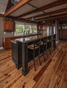 Moose Ridge Lodge Kitchen. Chick thru for more pics & fl plns of this smaller barn home. #barnhouseplans #barnhomes #smallhouseplans #smallhome #barnhomeplans #barnhouses #postandbeamhomes