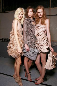 Valentino textures (Spring 2010) Love the leather and silk ruffled florals in the center here.
