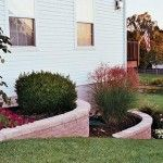 side yard landscaping cement steep hill grade retaining wall fower beds - Side Of House Landscaping With Retaining Wall Beds Front House Landscaping, Outdoor Landscaping, Landscaping Ideas, Lawn And Landscape, House Landscape, Sloped Yard, Lawn Fertilizer, Lawn Care, House Front