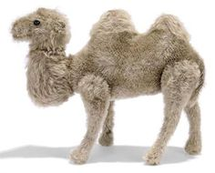 A STEIFF MOHAIR JOINTED BACTRIAN CAMEL, (5322), brown, black boot button eyes, pink stitching, swivel head, longer mohair head, neck and humps, squeaker and FF button with remains of white tag, circa 1910 --10in. (25.5cm.) long (faded and some slight wear)