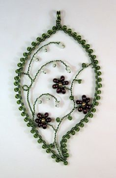 https://flic.kr/p/9mMt5n | Rivendell (mine) | Oh, for some decent daylight!  The flowers are actually iridescent purple.  Craft wire and seed beads.