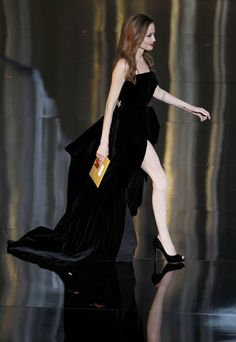 Jolie at the Oscars, 2012 - Pinned a couple of hours after the Oscars 2012... how quickly things go now-a-days... But the dress is amazing, and that long, white leg against the waves of black velvet... very effective.